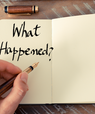 """A fountain pen and a notebook saying """"What Happened?"""""""